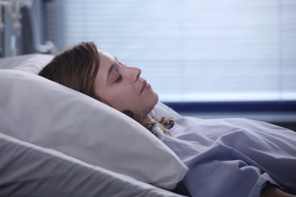 French Film Festival 19', 'Pure As Snow': Claire lying on the hospital bed.